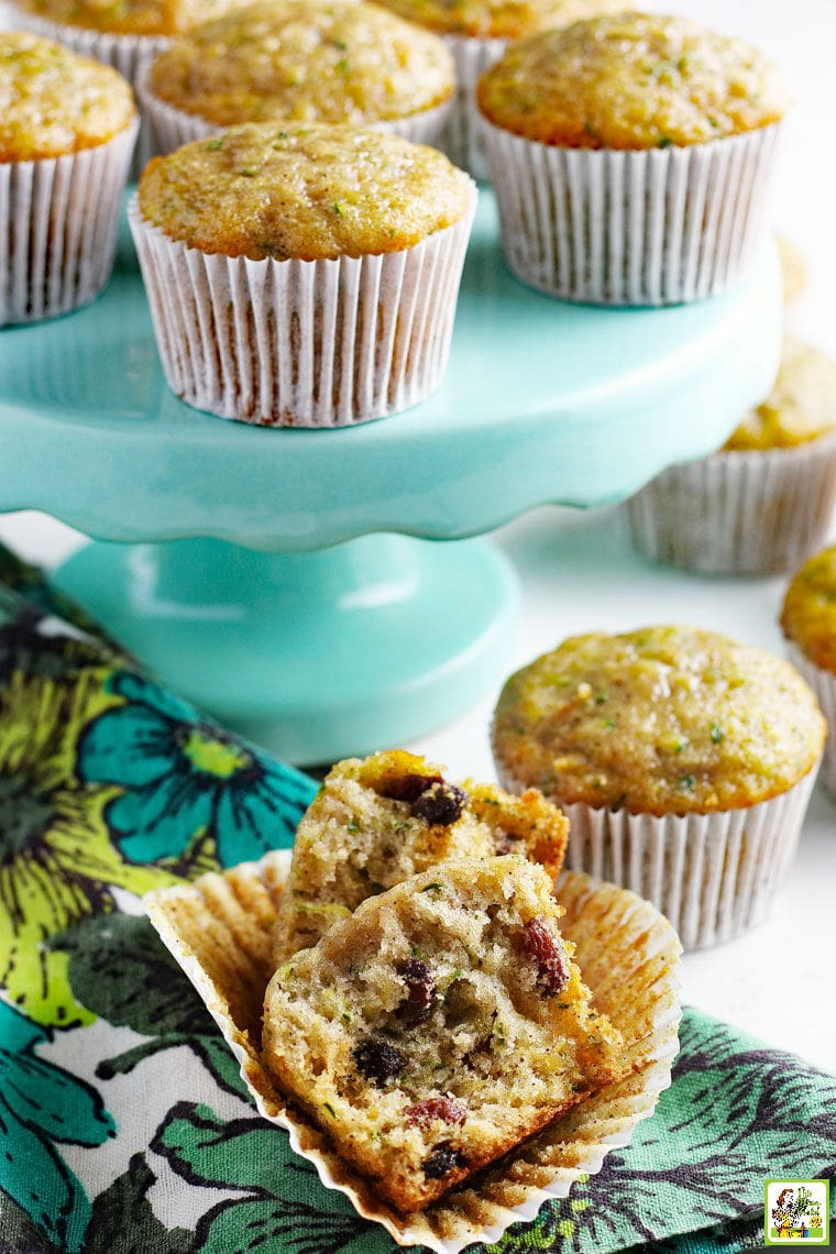 Zucchini Muffins on a turquoise cake stand with a floral napkin