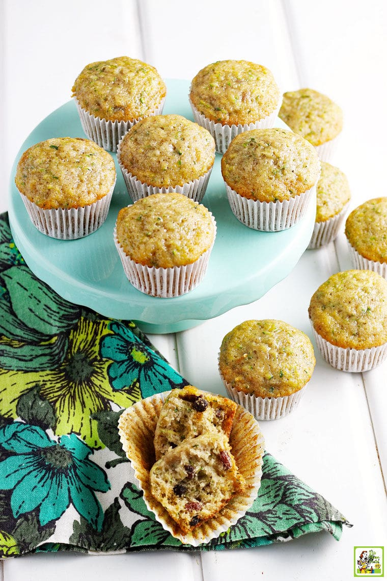 Dozens of muffins on and around a light teal green cake stand