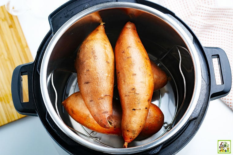 Sweet potatoes sitting on a trivet in a Instant Pot pressure cooker.