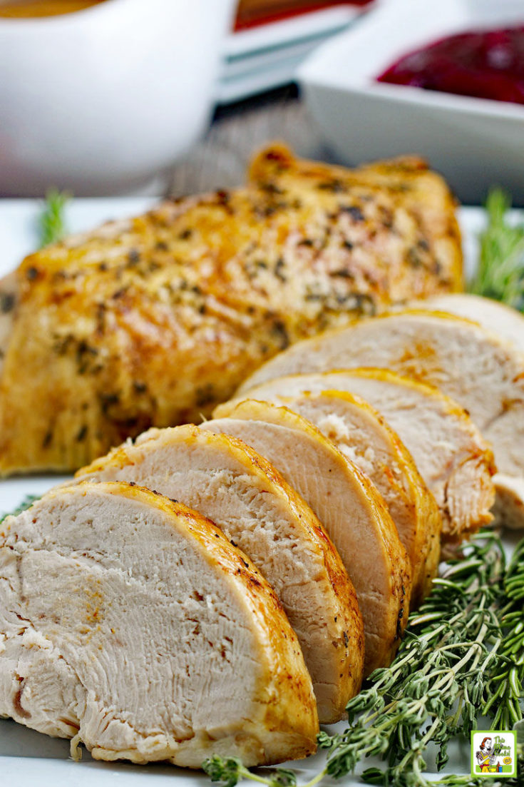 Sliced and roasted turkey breast with herbs.