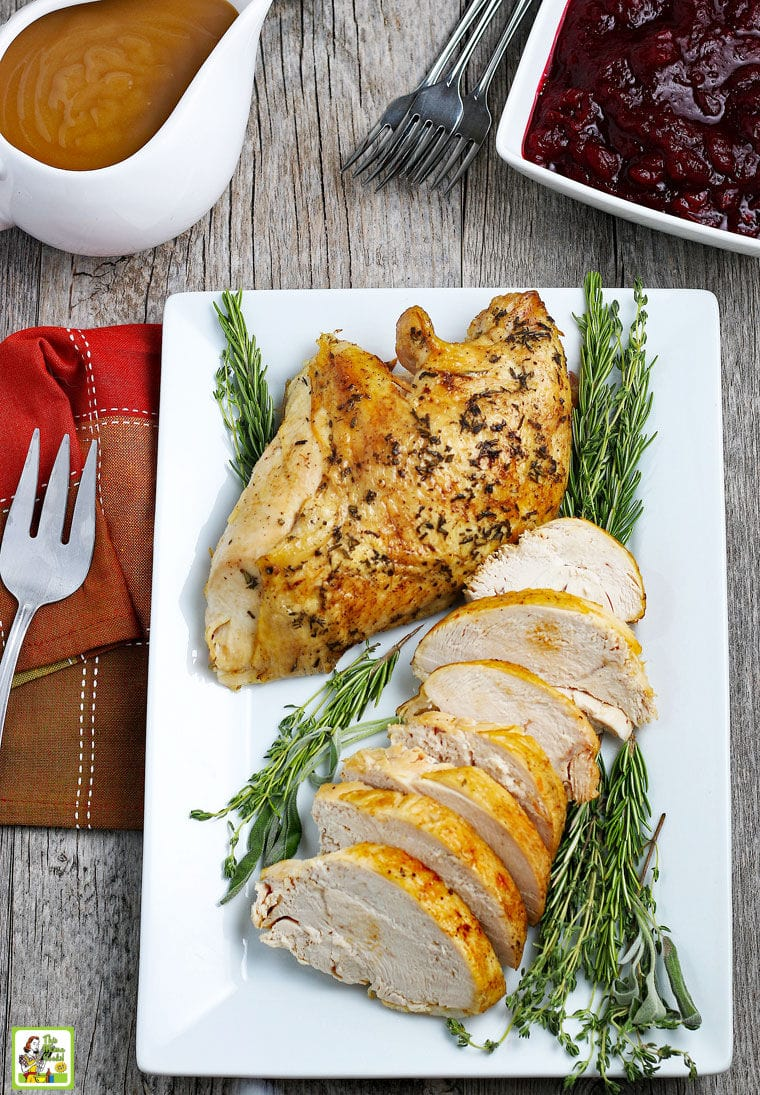 Cooked and sliced Turkey Breast on a white platter.