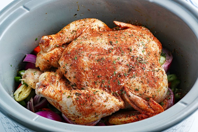 Cooking a chicken in a slow cooker.