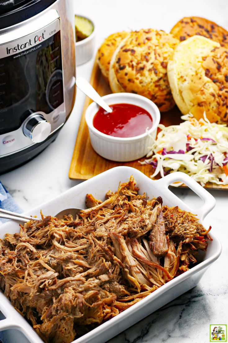 A platter of pulled pork, BBQ sandwich fixings, and an Instant Pot.