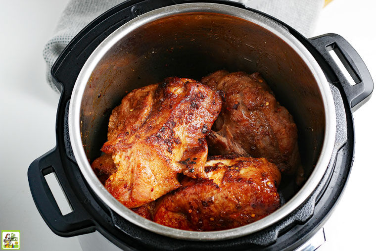 Place the browned pieces of pork back in the Instant Pot.