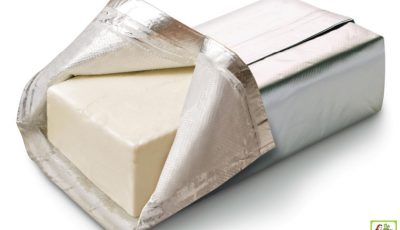 Block of opened cream cheese.