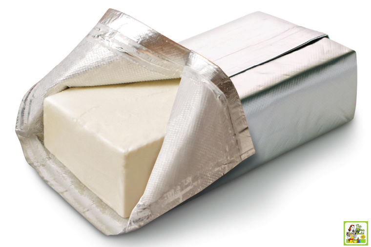 Block of opened cream cheese.