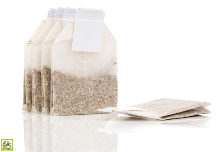 Stack of tea bags isolated on white background.